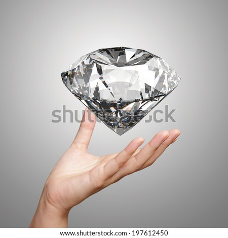 hand holding 3d diamond over white background  - stock photo