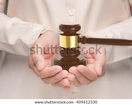 hand holding 3d rendering gavel judge - stock photo