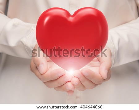 hand holding 3d rendering red heart