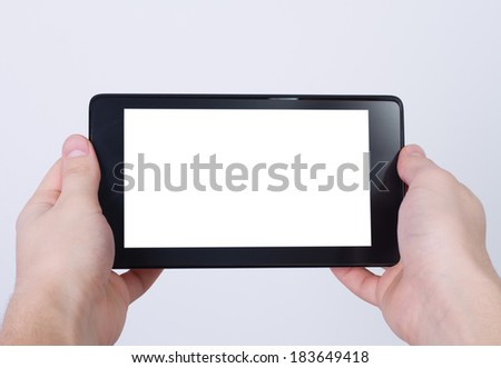 hand holding digital tablet pc with blank screen