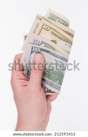 Hand holding dollar banknotes. Isolated on a white background.