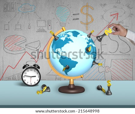 hand holding dollar chess on terrestrial globe with alarm clock and doodles wall - stock photo