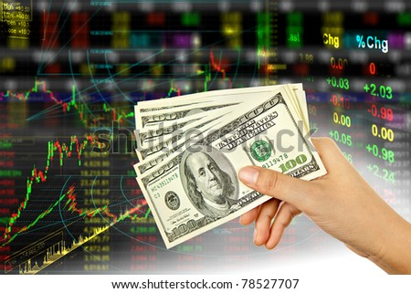 Hand holding dollar in stock background - stock photo