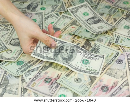 Hand holding dollars, concept of business and finance - stock photo