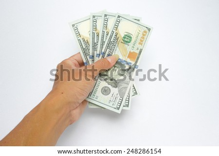Hand holding 100 dollars ( one hundred dollars banknote ) - stock photo