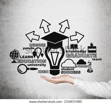 hand holding drawing education concept on wall - stock photo