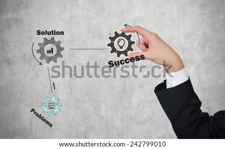 hand holding drawing success cogwheel and gears - stock photo