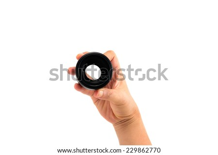 Hand holding DSLR lens from below isolated on white - stock photo