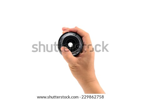 Hand holding DSLR lens from the right isolated on white - stock photo
