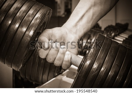 Hand holding dumbbell.Close up - stock photo