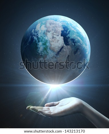 hand holding earth, space concept - stock photo