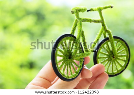 Hand Holding Eco bicycle icon,energy concept