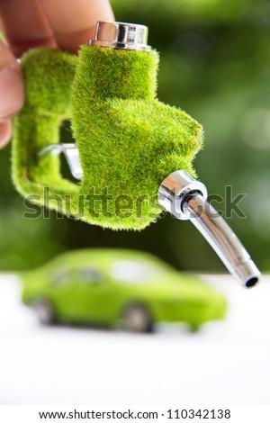 hand holding eco fuel nozzle,energy concept - stock photo