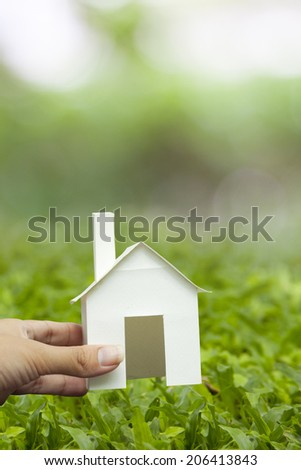 Hand holding eco house