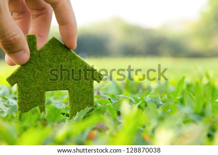 Hand holding eco house icon concept - stock photo