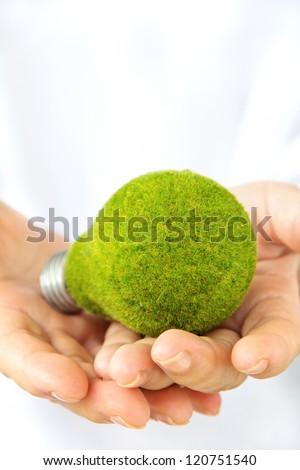 hand holding eco light bulb - stock photo