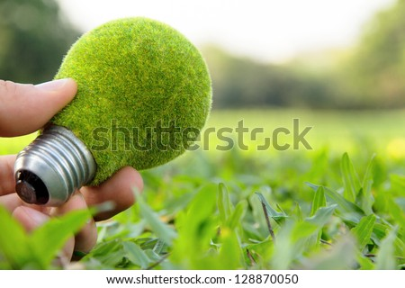 hand holding eco light bulb, save energy concept - stock photo