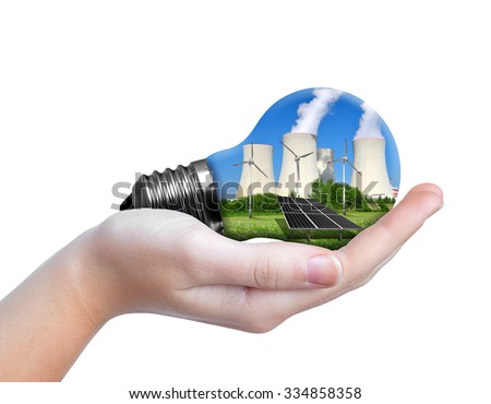Hand holding eco lightbulb isolated on white background. Energy resources concept. - stock photo