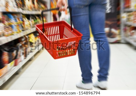 Hand holding empty shopping basket - Shopping concept  - stock photo