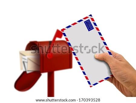 Hand Holding Envelope and Postal Box - stock photo