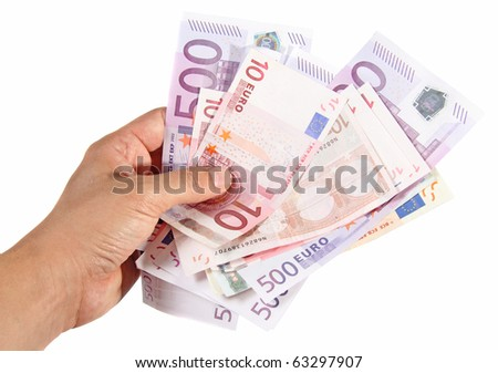Hand holding euro banknotes - stock photo
