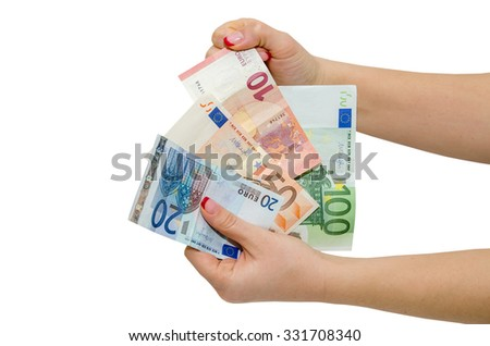 hand holding Euro banknotes isolated on a white
