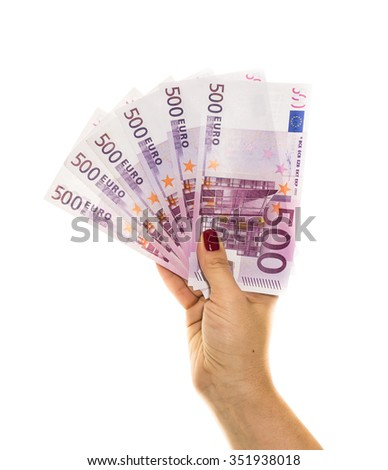 hand holding 500 euro money isolated on white background