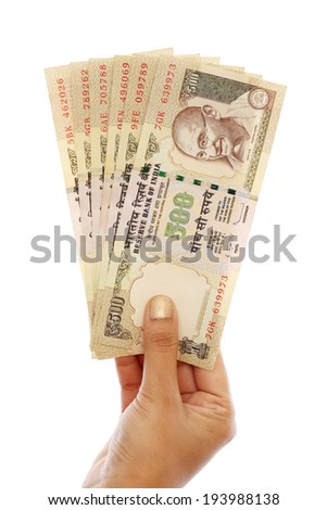 Hand holding five hundred Indian rupee notes against white background