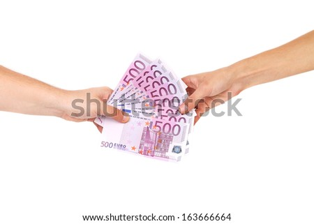 Hand holding five hundreds euro banknotes. Isolated on a white background. - stock photo
