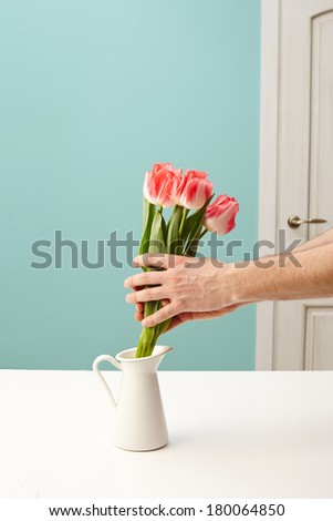 Hand Holding Flowers - stock photo