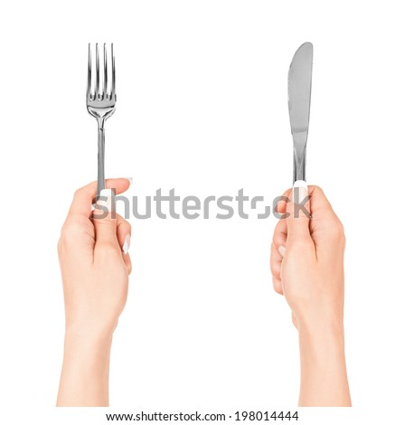 hand holding fork isolated on white background - stock photo
