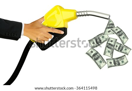 Hand holding Fuel nozzle pouring Dollar isolated on white background - stock photo