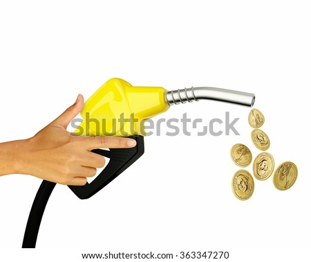 Hand holding Fuel nozzle with Golden coins isolated on white background - stock photo
