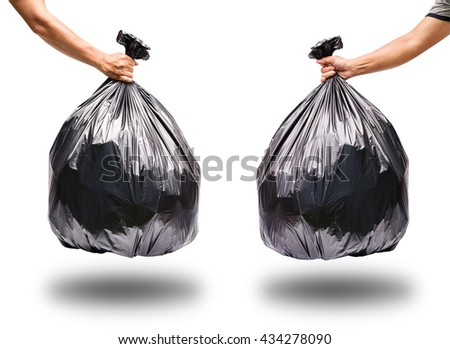 Hand holding garbage bag isolated on white background. With clipping path. - stock photo