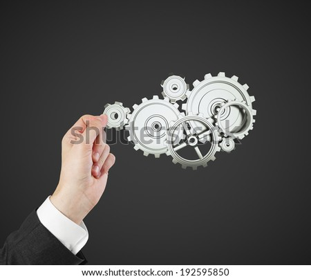 hand holding gears and cogwheels - stock photo