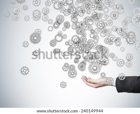 hand holding gears on a white background - stock photo