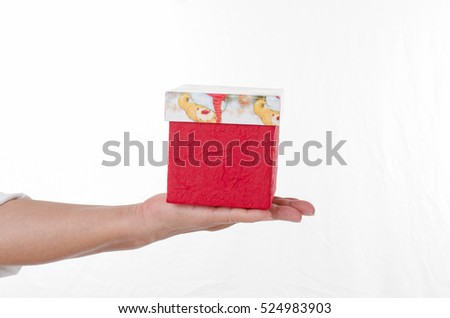 hand holding gift box over white background