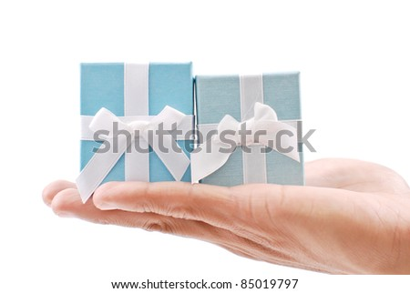Hand Holding 2 Gift Boxes - stock photo
