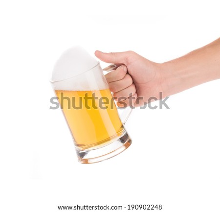 Hand holding glass full of beer. Isolated on a white background. - stock photo
