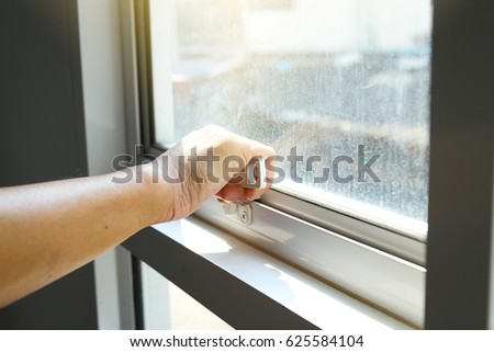hand holding glass window latch handle & Window Latch Stock Images Royalty-Free Images \u0026 Vectors ... Pezcame.Com