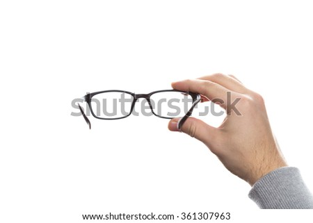 Holding eye glasses stock images royalty free images vectors hand holding glasses ccuart Gallery