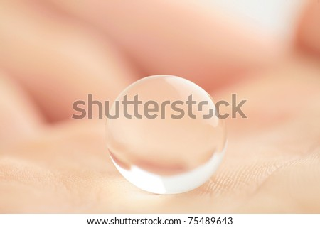 hand holding globe to protect the fragile environment - stock photo