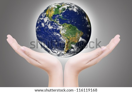 Hand Holding Glowing Earth Globe, Earth image provided by Nasa. http://visibleearth.nasa.gov/useterms.php - stock photo