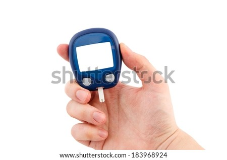 Hand holding glucometer with blank display isolated on white background