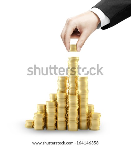 hand holding gold coins and build city - stock photo