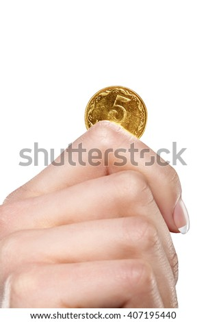 hand holding golden coin - stock photo