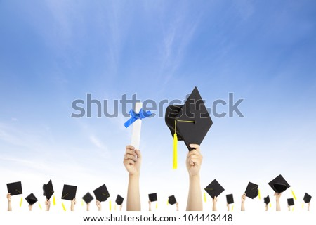 hand holding graduation hats and diploma certificate with cloud background - stock photo