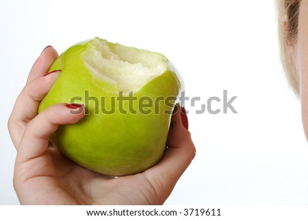 Hand holding green bitten apple. Isolated on white background. - stock photo