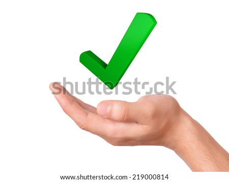 hand holding green check mark icon. success concept on white background - stock photo