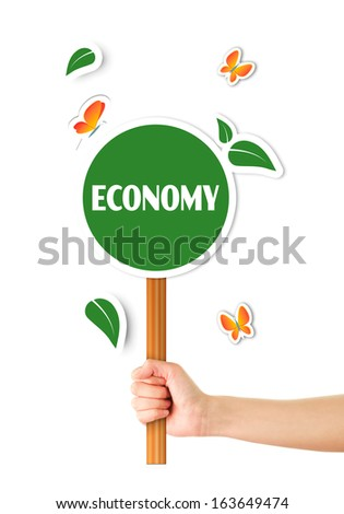 Hand holding green economy sign - stock photo